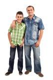 Vader en zoon, die op wit wordt geïsoleerdG Stock Afbeelding