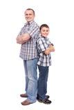 Vader en zoon die op wit wordt geïsoleerds Royalty-vrije Stock Foto's