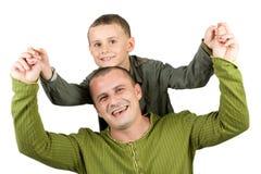 Vader en zoon die pret hebben Stock Foto's