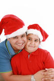 Vader en zoon met de hoeden van Kerstmis Stock Foto's