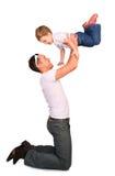 Vader met baby het spelen Stock Afbeelding