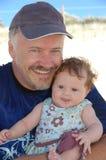 Vader met babymeisje Stock Foto's