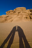 Vadi Rum desert. Shade of two people standing on desert Royalty Free Stock Photography