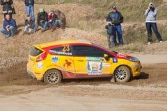 Vadim Zhenov drives a yellow Ford Fiesta Royalty Free Stock Photos