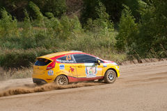Vadim Zhenov drives a yellow Ford Fiesta Stock Images