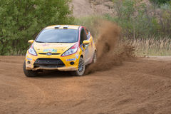 Vadim Zhenov drives a yellow Ford Fiesta car Stock Photography