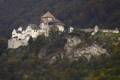 Vaduz castle. Is the official residence of the Prince of Liechtenstein. The Palace is named after the town of Vaduz, the capital of Liechtenstein, which it Stock Image