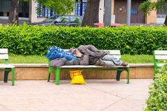 The vagabond on a bench in the park, Burgas in Bulgaria Stock Images
