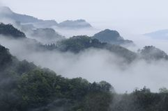 Vagaries of fog and mountains. Royalty Free Stock Image