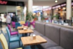 Vage achtergrond van kleurrijk binnenland bij de koffie royalty-vrije stock afbeeldingen