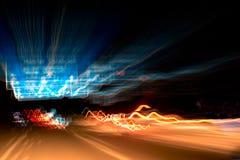 Vage achterlichten bij nacht op de weg Stock Afbeeldingen
