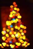 Vage feestelijke die achtergrond met Kerstmisboom en lichten wordt gemaakt Nieuwe jaarachtergrond Royalty-vrije Stock Foto's
