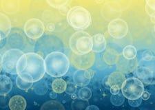 Vage geel-blauw bokeh achtergrond voor tekst, decoratie, abstractie met cirkels, sterren, sneeuwvlokken, waterimitatie, bellen royalty-vrije illustratie