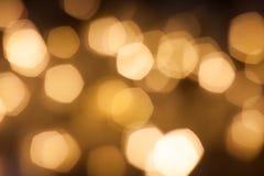 Vage gouden fonkelende feestelijke bokehachtergrond stock illustratie