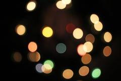 Vage het onduidelijke beeld defocused Kerstmis aansteekt bokeh lichte punten royalty-vrije stock afbeeldingen