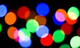 Vage kleurrijke feestelijke lichten stock fotografie