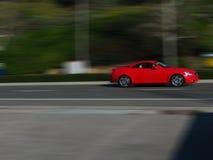 Vage motie rode auto Royalty-vrije Stock Afbeeldingen