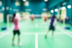 Vage spelers in badmintonhof Royalty-vrije Stock Afbeeldingen