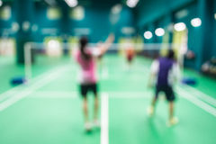 Vage spelers in badmintonhof Royalty-vrije Stock Foto's