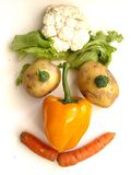 Vagetable face. A vegetable face with different vegetables Stock Photo