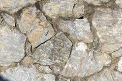 Vagga bakgrund för textur för stenväggen royaltyfri bild