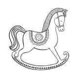 Vagga hästen på vit bakgrund Arkivfoton