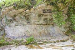 Vagga i sängen av en bergflod Fotografering för Bildbyråer