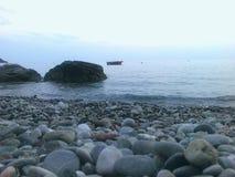 Vagga och havet Arkivfoto