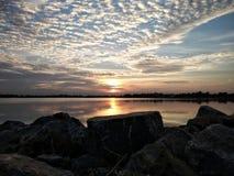Vagga - och - rullar solnedgången Fotografering för Bildbyråer