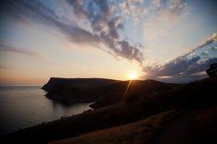 Vagga vid havet Krim i solnedgång Royaltyfri Fotografi