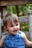 vaggande litet barn för 3 stol Arkivfoton