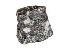 Vaggar den mineraliska stenen för makrokiseldioxid i på vit bakgrund fotografering för bildbyråer