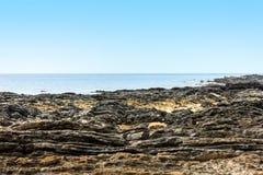 Vaggar på stranden Royaltyfria Bilder