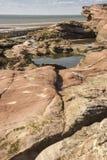 Vaggar, tips och klippan på den Hilbre ön, Wirral, England Arkivfoton