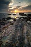 Strand på soluppgången Arkivbild