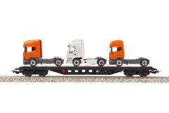 Vagone del carico del giocattolo con i camion Fotografia Stock Libera da Diritti