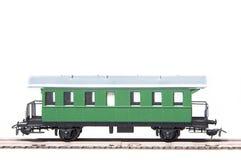 Vagone verde del giocattolo isolato su priorità bassa bianca Fotografia Stock Libera da Diritti