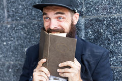 Vagrant with book Stock Image