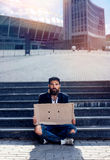 Vagrant with cardboard Royalty Free Stock Photo