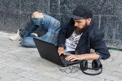 Vagrant with computer Royalty Free Stock Image
