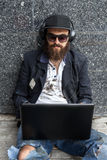 Vagrant with computer Stock Photography