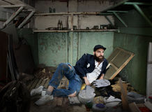 Vagrant in a dirty room Royalty Free Stock Photos
