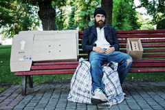 Vagrant in the park. Vagrant is sitting on the bench stock photo