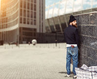 Vagrant peeing Royalty Free Stock Images