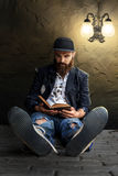 Vagrant reading Royalty Free Stock Photo