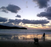 vague déferlante de coucher du soleil Image libre de droits