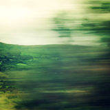 Vague view through moving car window - vintage filter. Defocused trees viewed through a car windscreen. Blurred action from car at high speed.  Ring of Kerry Royalty Free Stock Photography