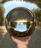 vai för crete glass handsphere Arkivbilder