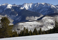 Vail. CO, USA - February 9, 2015: Skiers ride a chairlift gondola at  Mountain in , Colorado.  Mountain is located in the White River National Forest and is Royalty Free Stock Images