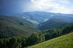 Vail valley and mountain in Colorado. Scenic view green forest in Vail valley with mountains in background, Colorado, USA Royalty Free Stock Photo